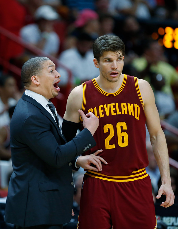 . Cleveland Cavaliers head coach Tyronn Lue talks with guard Kyle Korver (26) during overtime in an NBA basketball game against the Miami Heat, Monday, April 10, 2017, in Miami. The Heat defeated the Cavaliers 124-121 in overtime. (AP Photo/Wilfredo Lee)