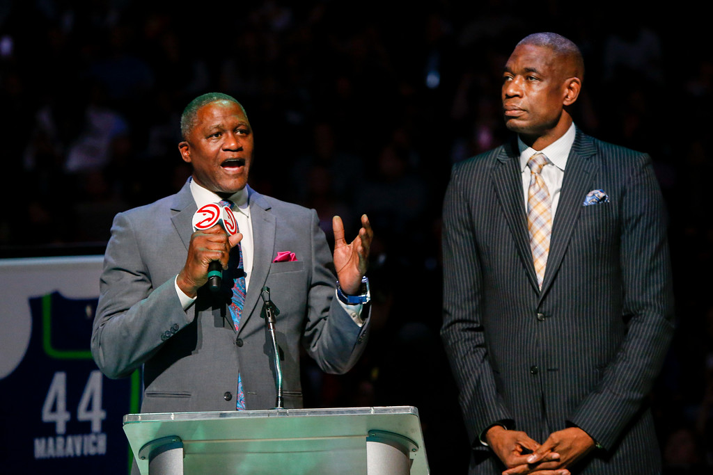 . Former Atlanta Hawks Dominique Wilkins, left, and Dikembe Mutombo speak at the jersey retirement ceremony of Pete Maravich during halftime of an NBA basketball game against the Cleveland Cavaliers, Friday, March 3, 2017, in Atlanta. (AP Photo/Brett Davis)