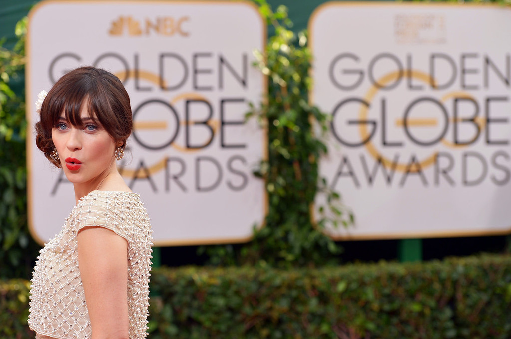 . Zooey Deschanel arrives at the 71st annual Golden Globe Awards at the Beverly Hilton Hotel on Sunday, Jan. 12, 2014, in Beverly Hills, Calif. (Photo by John Shearer/Invision/AP)