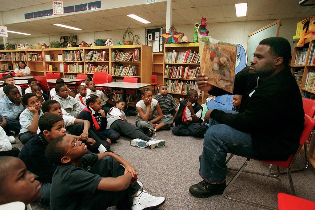 . Detroit Lions James Jones reads to children at Herrington Elementary School in Pontiac as part of Black History Reading Day.