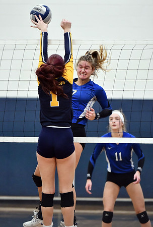 11/16/2019 Mike Orazzi | StaffrWoodstock Academy's Sierra Bedard (1) and Bristol Easterns Zoe Lowe (7) during the 2019 State Girls Volleyball Tournament Class L Quarterfinals at BEHS in Bristol Saturday. r