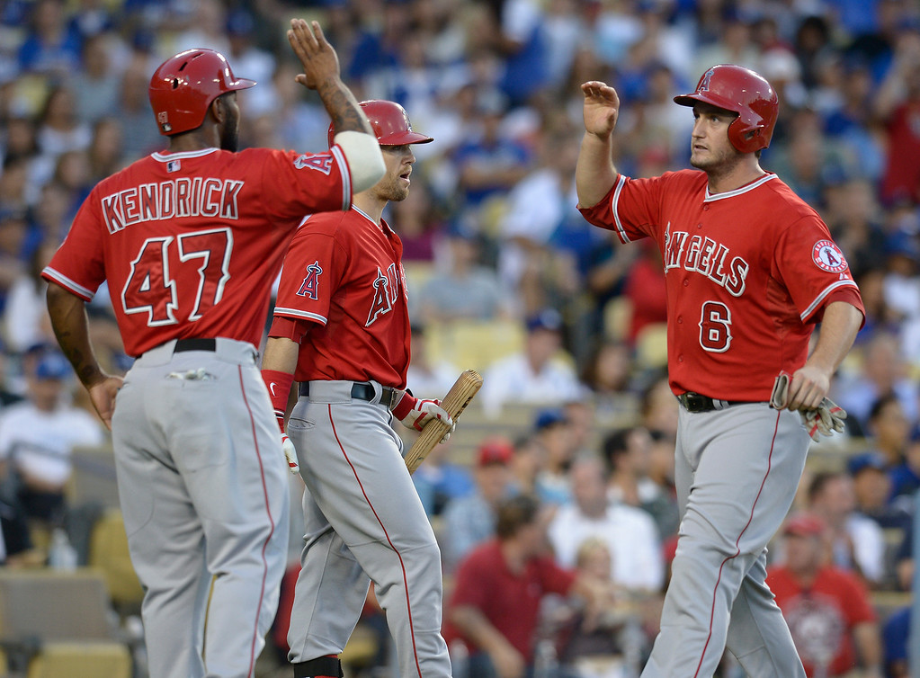 . Angels Howie Kendrick high fives David Freese after they were driven in by Chris Iannetta in the 2nd inning. The Dodgers played the Angels at Dodger Stadium in Los Angeles CA. 8/5/2014(Photo by John McCoy Daily News)