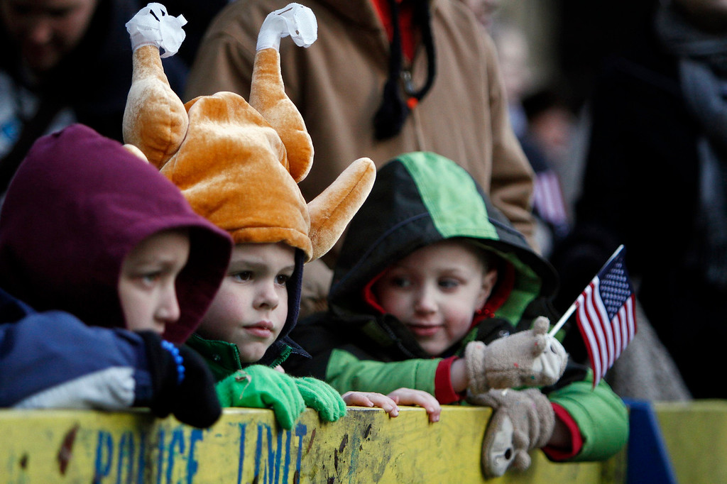 . From left to right, Sam Howell, 5, Andrew Halvorsen, 4, and Evan Howell, 4, watch the 94th annual Thanksgiving Day Parade, Thursday, Nov. 28, 2013, in Philadelphia. Officials say gusty winds limited use of balloons during parade. The National Weather Service reported winds of about 17 miles per hour gusting to 28 miles per hour at Philadelphia International Airport. (AP Photo/ Joseph Kaczmarek)