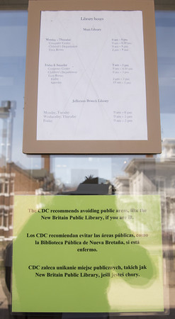 03/16/20 Wesley Bunnell | Staff A sign on the front door of the New Britain Public Library on Monday March 16, 2020 with a CDC advisory.