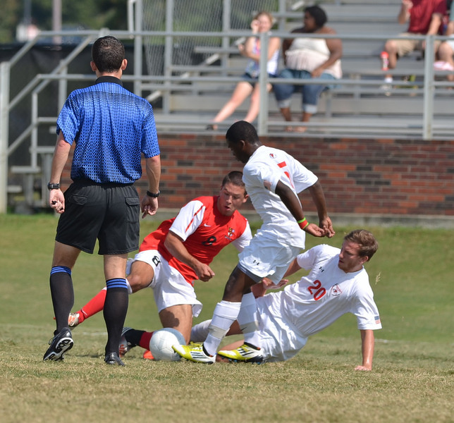John Sargent (20), along with Lyssean Thomas (5) work hard to get the ball from the opposing side.