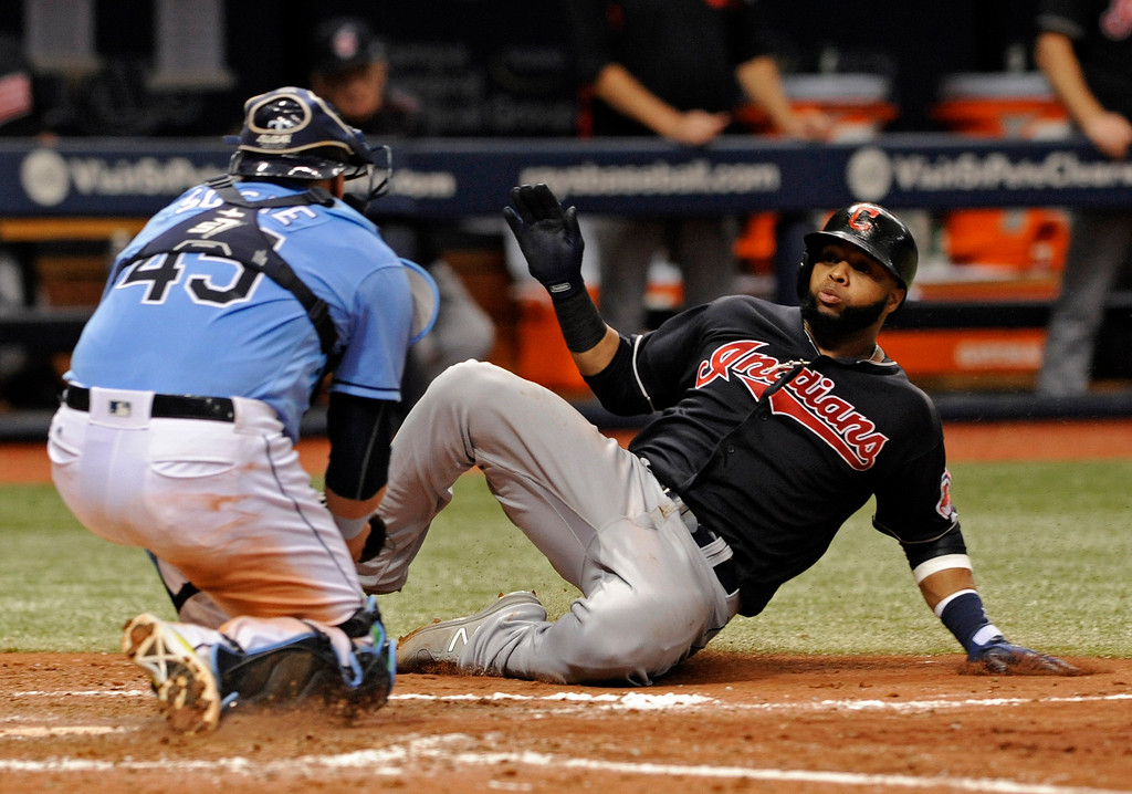 . Tampa Bay Rays catcher Jesus Sucre, left, tags out Cleveland Indians\' Carlos Santana as he tried to score on Francisco Lindor\'s single and was thrown out by Rays right fielder Steven Souza Jr. during the seventh inning of a baseball game, Sunday, Aug. 13, 2017, in St. Petersburg, Fla. (AP Photo/Steve Nesius)