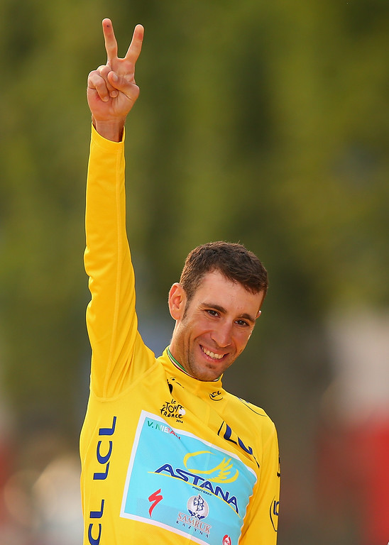 . Vincenzo Nibali of Italy and Astana Pro Team celebrates victory in the yellow jersey on the podium following the twenty first stage of the 2014 Tour de France, a 138km stage from Evry into the Champs-Elysees, on July 27, 2014 in Paris, France.  (Photo by Bryn Lennon/Getty Images)
