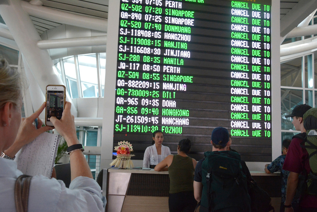 . A flight information board shows cancelled flights at Ngurah Rai International Airport in Bali, Indonesia, Tuesday, Nov. 28, 2017. Indonesia\'s disaster mitigation agency says the airport on the tourist island of Bali is closed for a second day due to the threat from volcanic ash. (AP Photo/Ketut Nataan)