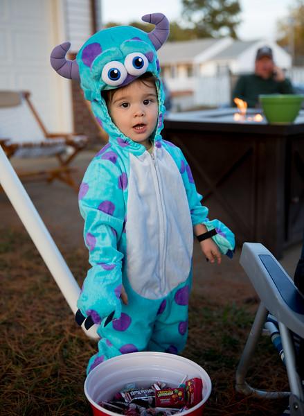 Caleb Standing over Candy Bucket.jpg