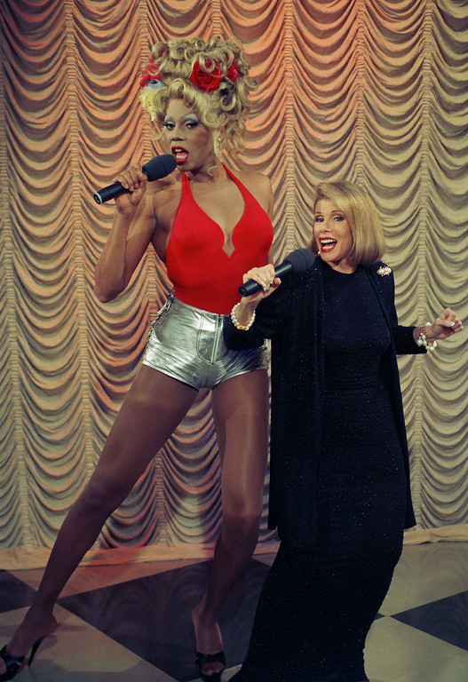 ". Entertainer RuPaul, left, sings a number from his debut album ""Supermodel of the World\"" with Joan Rivers during taping of her show in New York, July 28, 1993. The drag queen also discussed his soon-to-be released book \""My Supermodel\"" on the show. (AP Photo/Jim Cooper)"