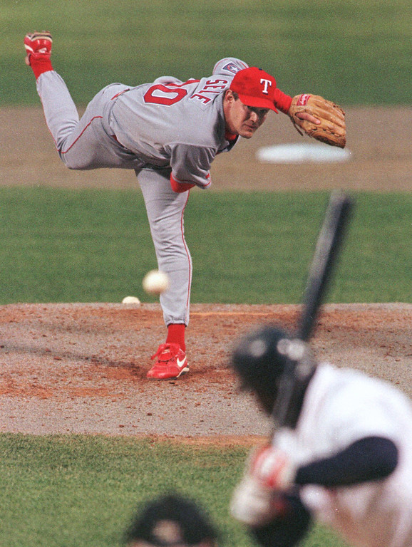 . AARON SELE -- Texas Rangers pitcher Aaron Sele lets go with a pitch to former teammate Mo Vaughn during first inning action at Fenway Park in Boston on May 1, 1998. (AP Photo/Winslow Townson)
