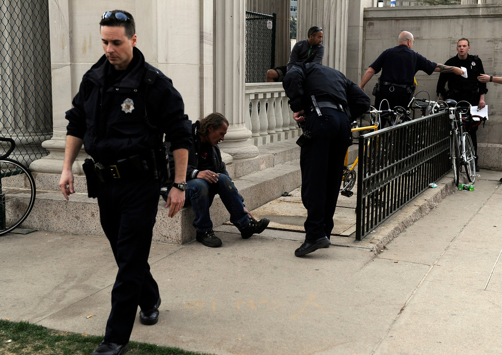 . DENVER, CO. - APRIL 20TH: Denver Police officers secure an area of the southeast corner of Civic Center Park after a shooting Saturday afternoon, April 20th, 2013. (Photo By Andy Cross/The Denver Post)