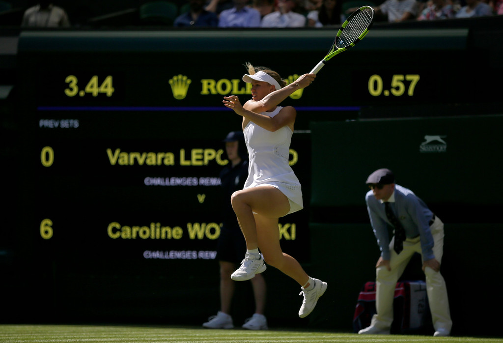. Caroline Wozniacki of Denmark, returns the ball to Varvara Lepchenko, of the United States, during their Women\'s Singles first round match at the Wimbledon Tennis Championships in London, Monday July 2, 2018. (AP Photo/Tim Ireland)