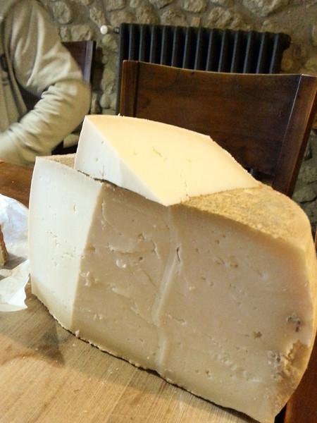 goat cheese wheel cut.jpg