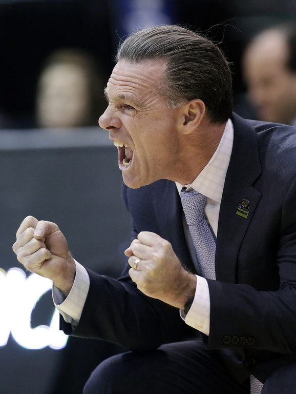 . Pittsburgh head coach Jamie Dixon shouts to his team during the first half during a second-round game in the NCAA college basketball tournament against Wichita State in Salt Lake City, Thursday, March 21, 2013. (AP Photo/Rick Bowmer)