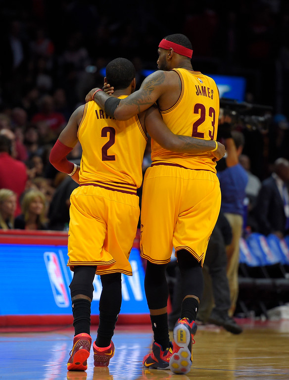 . Cleveland Cavaliers guard Kyrie Irving, left, and forward LeBron James hug during the second half of an NBA basketball game against the Los Angeles Clippers, Friday, Jan. 16, 2015, in Los Angeles. The Cavaliers won 126-121. (AP Photo/Mark J. Terrill)