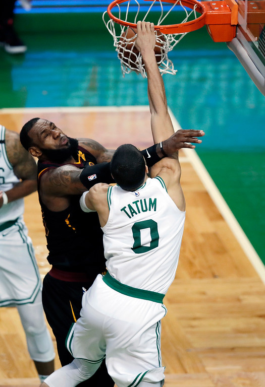 . Boston Celtics forward Jayson Tatum dunks against Cleveland Cavaliers forward LeBron James, left, during the second half in Game 7 of the NBA basketball Eastern Conference finals, Sunday, May 27, 2018, in Boston. (AP Photo/Charles Krupa)