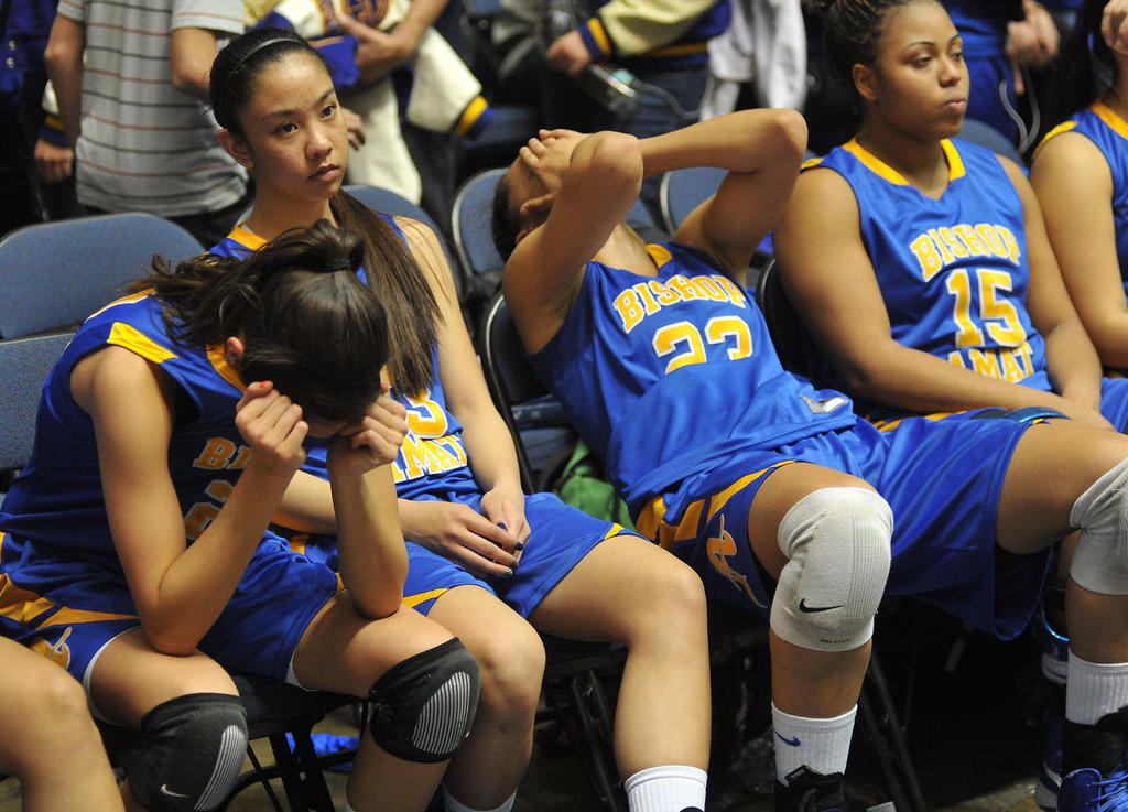 . Bishop Amat players react to their loss to Canyon Springs in the CIF-SS Division 1A girls basketball finals at the Anaheim Arena on Friday March 1, 2013. Canyon Springs beat Bishop Amat 48-46. (SGVN/Staff Photo by Keith Durflinger)