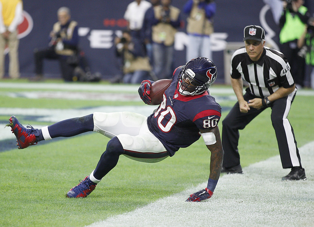. HOUSTON, TX - DECEMBER 28: Andre Johnson #80 of the Houston Texans catches a touchdown pass against  the Jacksonville Jaguars in the fourth quarter in a NFL game on December 28, 2014 at NRG Stadium in Houston, Texas. (Photo by Bob Levey/Getty Images)
