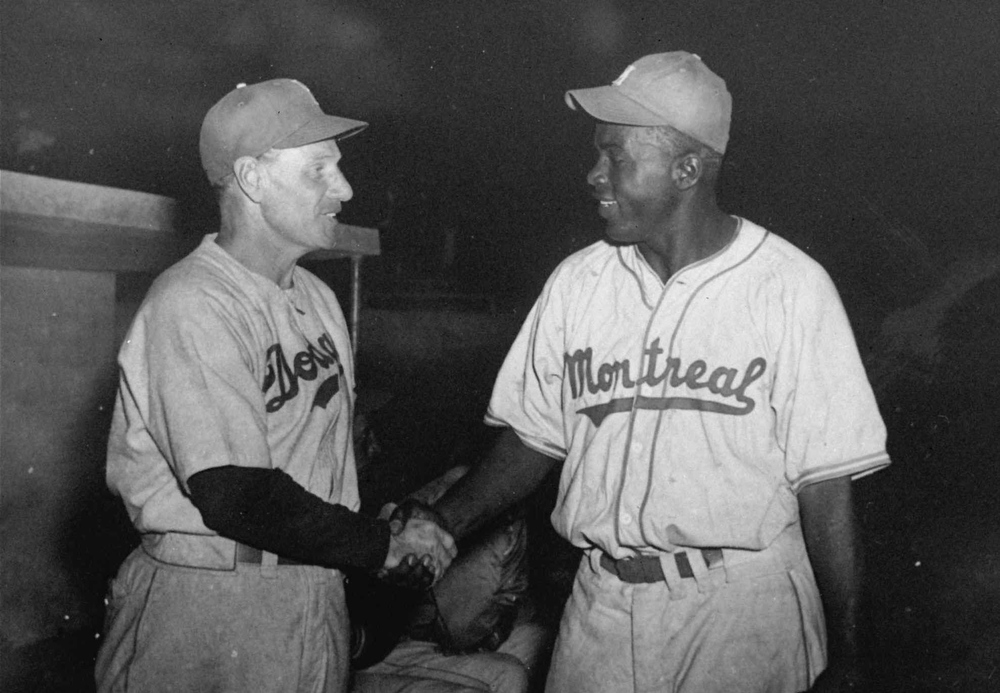 Description of . Brooklyn Dodgers manager Leo Durocher, left,  shakes hands with Montreal Royals\' Jackie Robinson prior to an exhibition game in Havana, Cuba, March 31, 1947. Robinson broke the color barrier and changed baseball forever. (AP Photo/file)