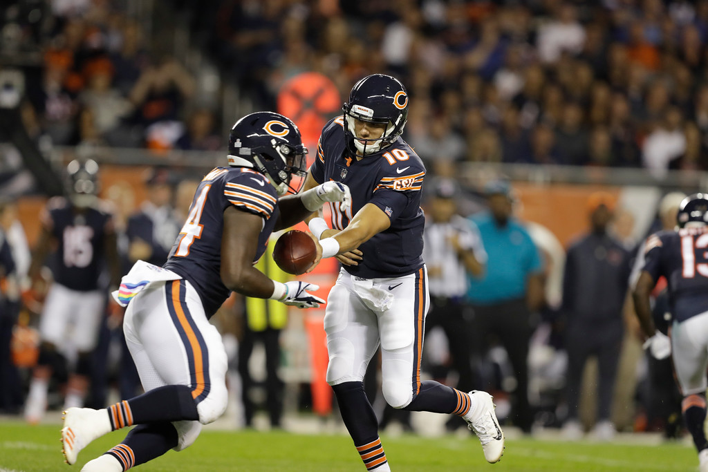 . Chicago Bears quarterback Mitchell Trubisky (10) hands of the running back Jordan Howard (24) during the first half of an NFL football game, against the Minnesota Vikings Monday, Oct. 9, 2017, in Chicago. (AP Photo/Darron Cummings)