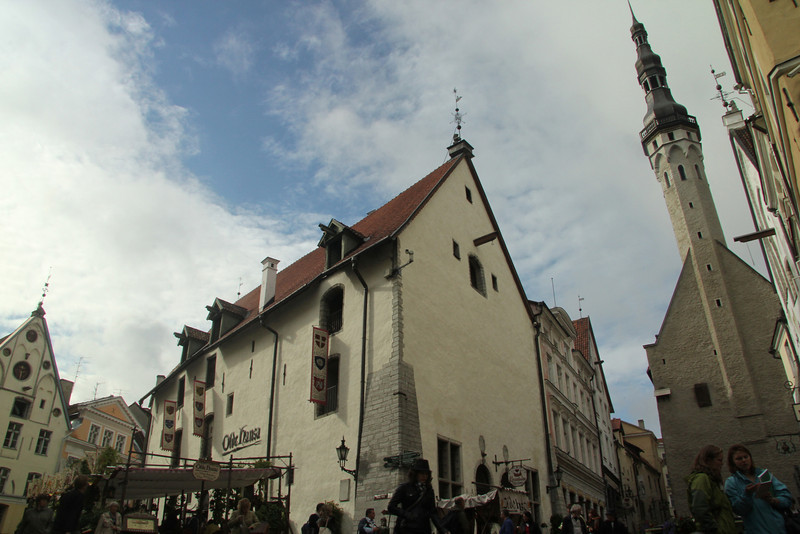 """A famous and popular medieval restaurant, """"Olde Hansa"""" on left and Town Hall on the right -Tallinn, Estonia"""