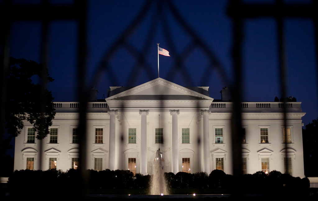 . The White House in Washington is seen at night, Monday, Sept. 30, 2013. President Obama is ramping up pressure on Republicans to avoid a post-midnight government shutdown, saying a shutdown would hurt the economy and hundreds of thousands of government workers. (AP Photo/Pablo Martinez Monsivais)
