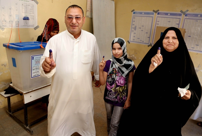 . Iraqi\'s show their inked fingers after casting their votes for parliamentary elections at a polling in Baghdad, Iraq, Wednesday, April 30, 2014. Iraq is holding its third parliamentary elections since the U.S.-led invasion that toppled dictator Saddam Hussein.  More than 22 million voters are eligible to cast their ballots to choose 328 lawmakers out of more than 9,000 candidates. (AP Photo/Karim Kadim)