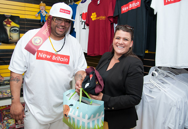 06/07/18 Wesley Bunnell | Staff The Hive in downtown New Britain held a ribbon cutting ceremony on Thursday afternoon after a soft opening earlier in the year. The shop carries New Britain clothing as well as an assortment of small electronics. Co-owner Steve Ayala bags up Mayor Erin Stewarts purchases after the ribbon cutting.