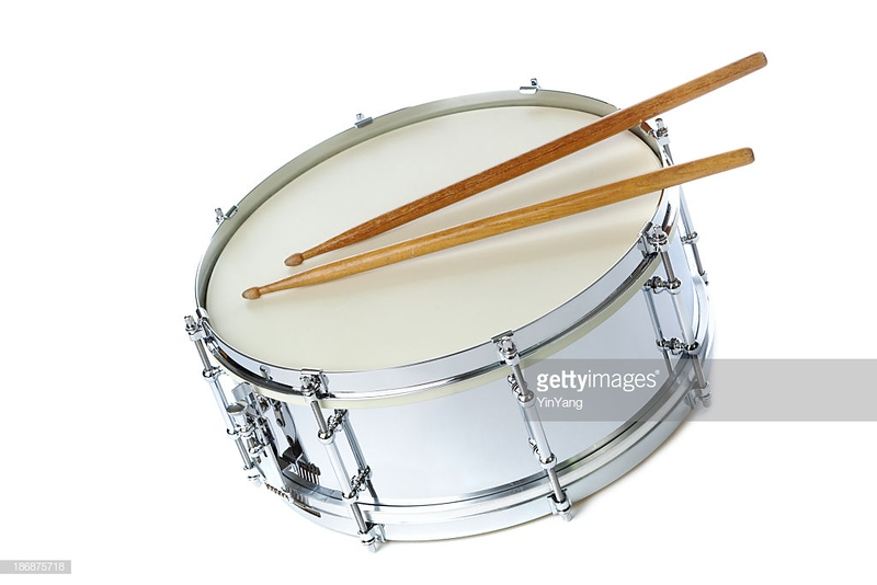 A silver chrome snare drum with drum sticks. The percussion musical instrument is isolated on a white background.