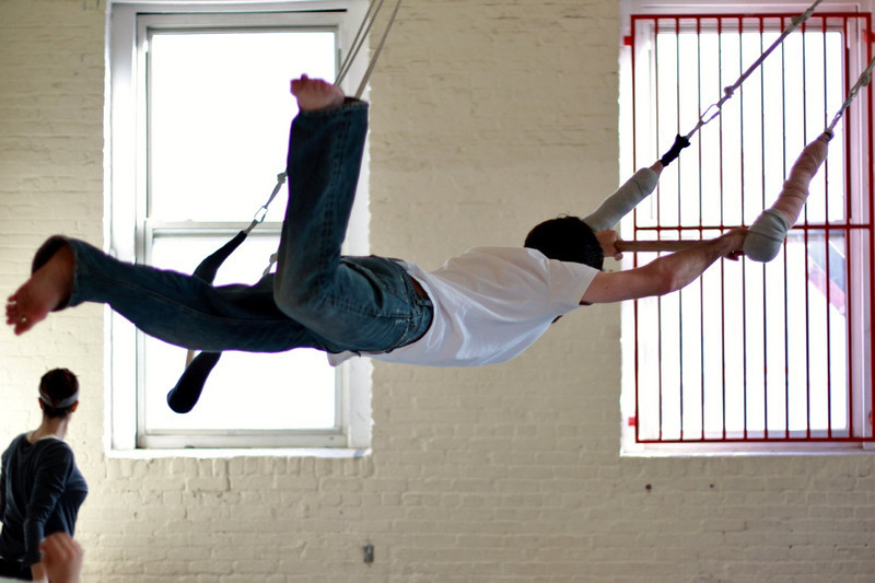 Justin takes flight on the low flying trapeze