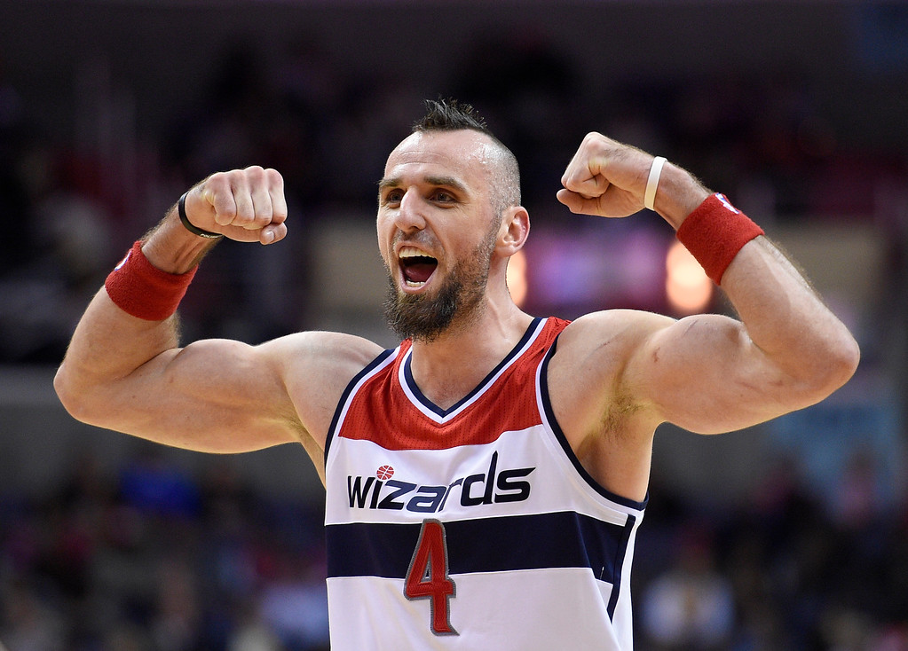 . Washington Wizards center Marcin Gortat, of Poland, reacts during the second half of an NBA basketball game against the Denver Nuggets, Friday, Dec. 5, 2014, in Washington. (AP Photo/Nick Wass)