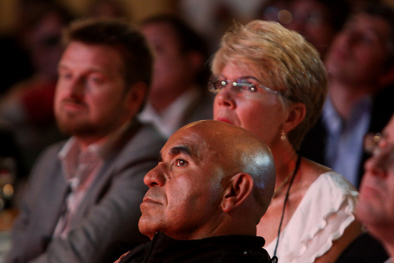 """Johan Varland (L), Kamran Elahian, and Mary Clark listen to """"Practical Strategies for Solving the Climate Problem"""" on Opening Night, presented by V. """"Ram"""" Ramanathan, Distinguished Professor of Climate Sciences and Director of C4, Scripps, UCSD"""