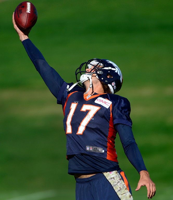 . Quarterback Brock Osweiler makes a grab as he practices with the other passers. The Denver Broncos football team gets in their final day of practice during training camp at Dove Valley on Friday, Aug. 15, 2014. (Photo by Kathryn Scott Osler/The Denver Post)