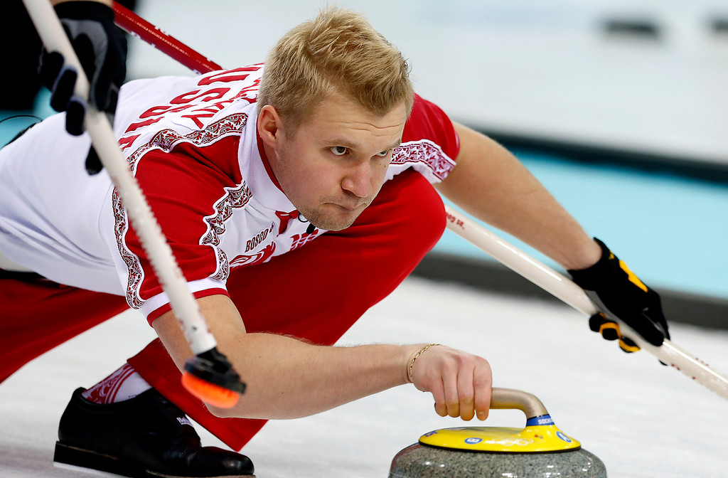 . Russia\'s skip Alexei Stukalskiy, delivers the rock during the men\'s curling competition against Switzerland at the 2014 Winter Olympics, Thursday, Feb. 13, 2014, in Sochi, Russia. (AP Photo/Wong Maye-E)