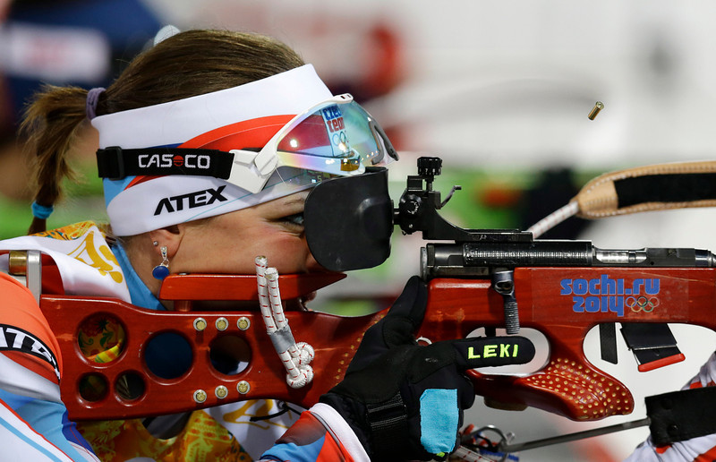 . Czech Republic\'s Jitka Landova ejects the cartridge as she shoots during the women\'s biathlon 4x6k relay at the 2014 Winter Olympics, Friday, Feb. 21, 2014, in Krasnaya Polyana, Russia. (AP Photo/Kirsty Wigglesworth)