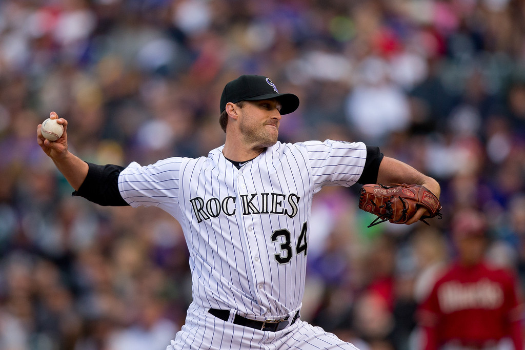 . Relief pitcher Matt Belisle #34 of the Colorado Rockies delivers to home plate during the eighth inning against the Arizona Diamondbacks at Coors Field on April 6, 2014 in Denver, Colorado. The Diamondbacks defeated the Rockies 5-3. (Photo by Justin Edmonds/Getty Images)
