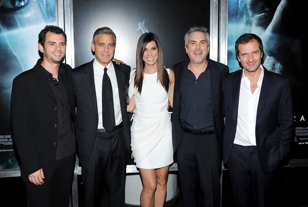 """. From left, screenwriter Jonas Cuaron, actor George Clooney, actress Sandra Bullock, director Alfonso Cuaron and producer David Heyman pose together at the premiere of \""""Gravity\"""" at the AMC Lincoln Square Theaters on Tuesday, Oct. 1, 2013, in New York. (Photo by Evan Agostini/Invision/AP)"""