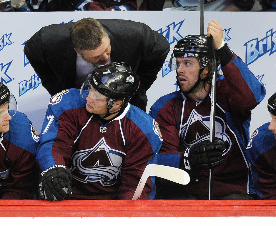 . Colorado coach Patrick Roy gave some advice to center John Mitchell (7) in the first period Wednesday night.  Photo By Karl Gehring/The Denver Post