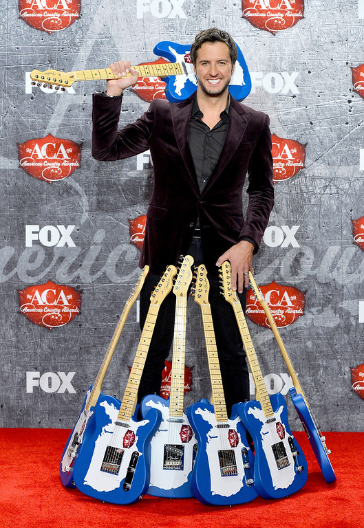 . LAS VEGAS, NV - DECEMBER 10:  Singer Luke Bryan poses in the press room with multiple awards during the 2012 American Country Awards at the Mandalay Bay Events Center on December 10, 2012 in Las Vegas, Nevada.  (Photo by Frazer Harrison/Getty Images)