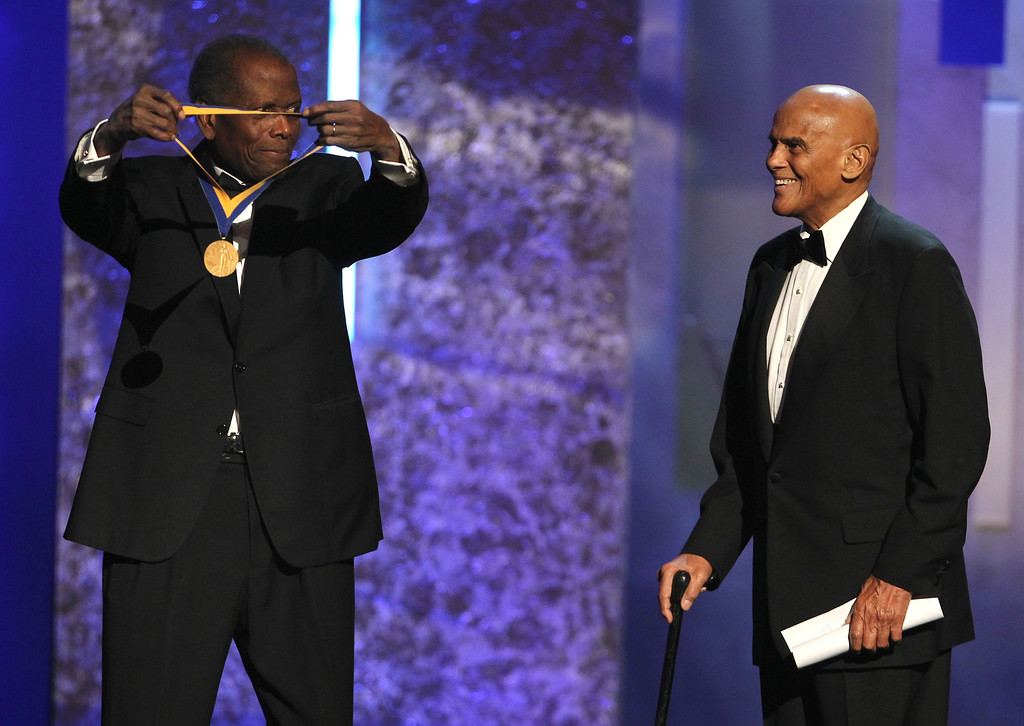 . Sidney Poitier, left, presents the Spingarn award to Harry Belafonte at the 44th Annual NAACP Image Awards at the Shrine Auditorium in Los Angeles on Friday, Feb. 1, 2013. (Photo by Matt Sayles/Invision/AP)