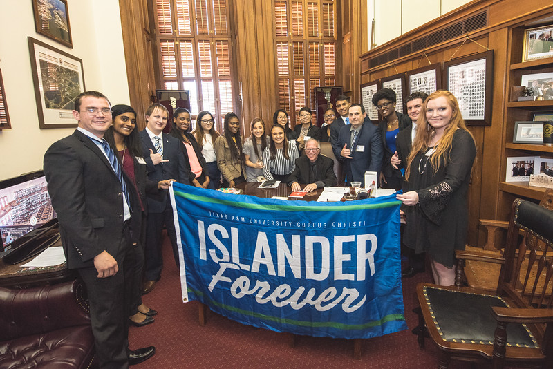 TAMU-CC students gather for a group photo in Todd Hunters office.