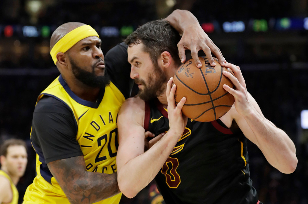. Indiana Pacers\' Trevor Booker, left, puts pressure on Cleveland Cavaliers\' Kevin Love in the first half of Game 5 of an NBA basketball first-round playoff series, Wednesday, April 25, 2018, in Cleveland. (AP Photo/Tony Dejak)