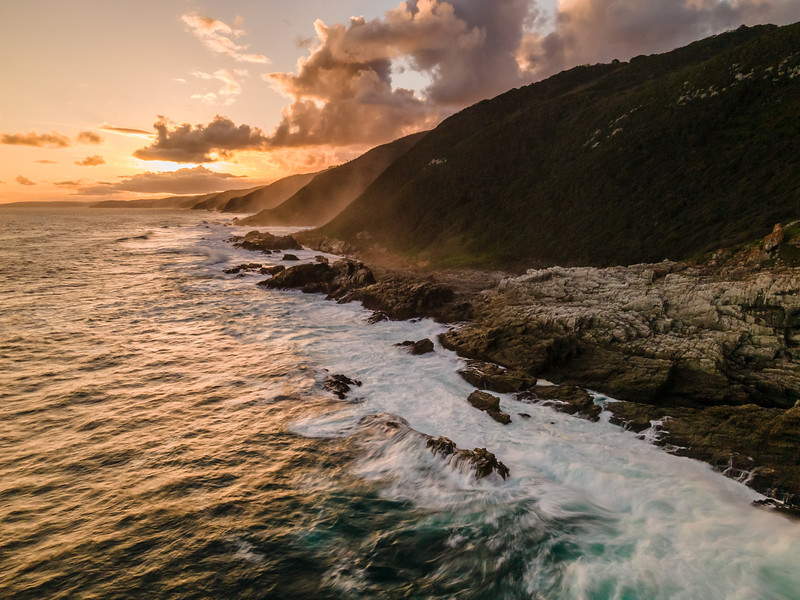 Aerial view of Otter Trail seaside cliffs at sunset, Eastern Cape, South Africa
