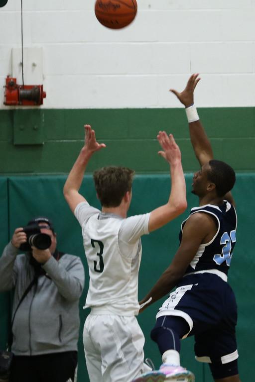 . 2018 - Basketball - Benedictine at Lake Catholic.  Benedictine defeated Lake Catholic 63-56.  Benedictine\'s Chris Jefferson (32) puts up a running jumpshot against Lake Catholic\'s Sean Fitzgerald (3).
