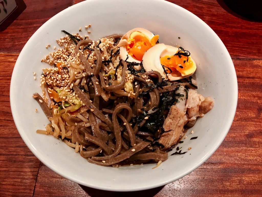 Soba topped with pork, vegetables, and boiled egg.