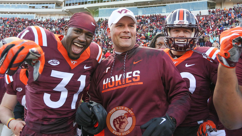 Brandon Facyson (31) and Wright Bynum (89) celebrate with head coach Justin Fuente after his gatorade bath. (Mark Umansky/TheKeyPlay.com)