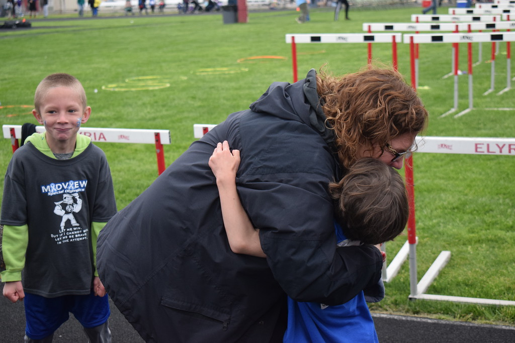 . Briana Contreras � The Morning Journal <br> Intervention Specialist Franca Demuth of the Olmsted Falls Early Childhood Learning Center hugs her student Olivia Hargenrader, 6, after giving all she had while racing in the 50 Meter Dash at the 38th Annual Lorain County Special Olympics Track and Field Event held on May 11 at Ely Stadium in Elyria.