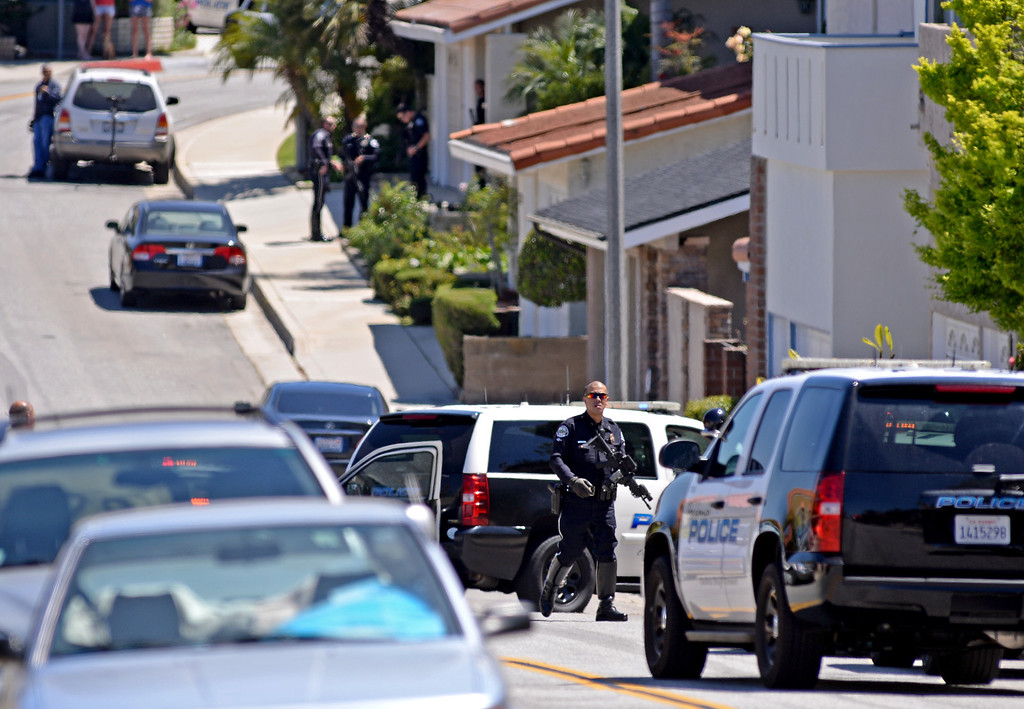 . Torrance PD officer converged en mass to the 3900 block of Mesa Street on Friday after a call came in refering to a shooting at State Senator Ted Lieu\'s home. It turned out to be a prank call at about 1p.m. Photo by Brad Graverson 4-19-13