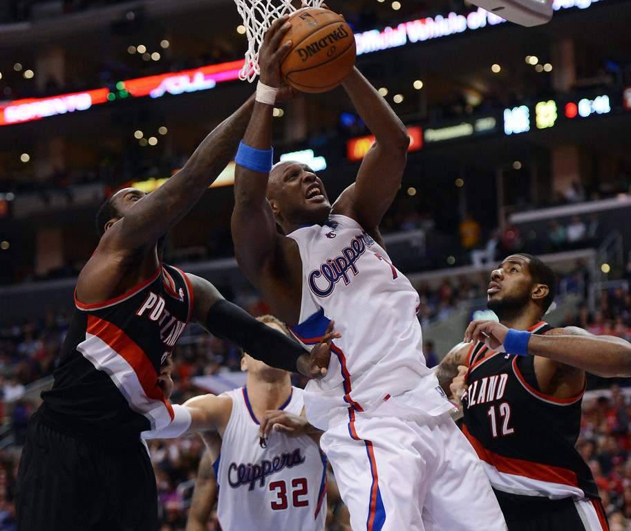 . The Clippers\'  Lamar Odom #7 grabs a rebound during their game against the Trail Blazers at the Staples Center in Los Angeles Sunday, January 27, 2013.  (Hans Gutknecht/Los Angeles Daily News)